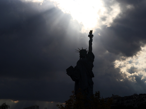Threatening sky over the replica of the Statue of Liberty